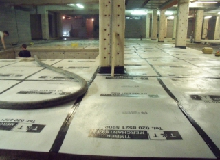 Finished Screed protected with plastic covering which slows down the Curing Process