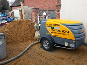 Screeding Labourer Mixing Using a Screed Pump